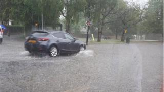 Car in standing water