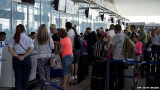 British tourists queue up at the Enfidha International airport as they leave Tunisia