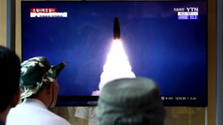 Missile launch on television screen