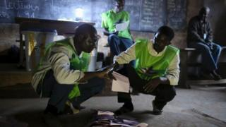 Electoral observers count votes at the end of the presidential and legislative elections, in the mostly muslim PK5 neighbourhood of Bangui