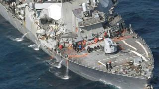 Helicopter images show the damaged ship