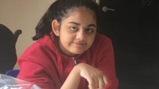 Diya in her kitchen