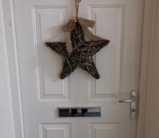 Christmas star on door