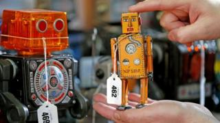 Andy Reed, die cast specialist at Vectis Auctions holds Robot Lilliput from Japan, a wind up robot from 1939