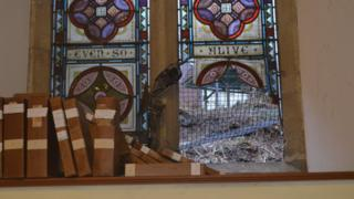 A broken stained-glass window at Christ Church