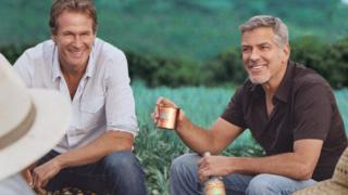 Rande Gerber and George Clooney in field of agave in promotional shot for Casamigos
