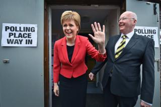 SNP Leader Nicola Sturgeon after voting in the Scottish Parliamentary election, pictured with her husband Peter Murrel at Broomhouse Community Hall in Glasgow, Scotland
