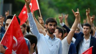 "Turks protest outside the German Consulate in Istanbul, 2 Jun 16, against German approval of a resolution recognising the 1915 massacre of Armenians by Ottoman forces as ""genocide"""