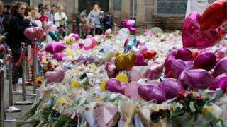 "Balloons and flowers at a makeshift memorial at St Ann""s Square, Manchester"