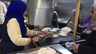 Women making chapatti