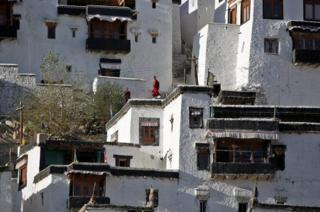 Young monks take a break from their studies inside Thiksey Monastery in Ladakh, India.