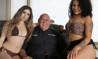 Dennis Hof with two sex workers
