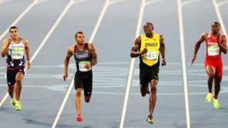 Adam Gemili of Great Britain, Andre De Grasse of Canada, Usain Bolt of Jamaica and Salem Eid Yaqoob of Bahrain compete in the men's 200m semi-final