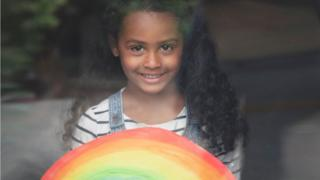 in_pictures Lotie Ellis Lye-Scott, 4, loves being photographed behind her rainbow. There's no escaping lessons for her because her mother is a teacher.