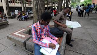 Students read at the University of Lagos, 2012
