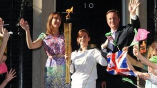 Samantha Cameron and her husband David outside No 10 with the Olympic torch in 2012