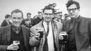 "Architects John Cowell (l) and Isi Metzstein (r) - and project manager Stan Blair in the centre - celebrate at the ""topping out"" ceremony in 1965"