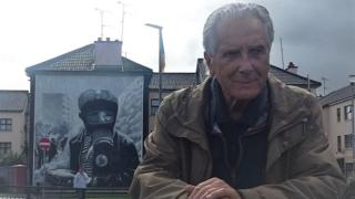 Clive Limpkin in front of mural