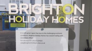 Sign in the window of Brighton Holiday Homes