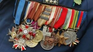 A photo of army veteran medals on a jacket