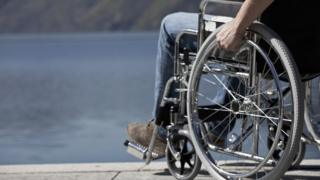 Stock photo of man in wheelchair