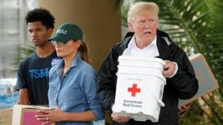 President Donald Trump and first lady Melania Trump help volunteers deliver supplies to residents in Houston, Texas.