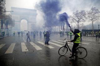 Protesters wearing yellow vests near the Arc de Triomphe in Paris, France