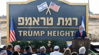 "Israeli Prime Minister Benjamin Netanyahu gives a speech before the newly-unveiled sign for the new settlement of ""Ramat Trump"", or ""Trump Heights"""