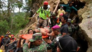 Man on stretcher at Indonesian mine