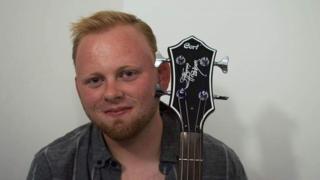 Simon Jones holding a bass