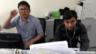 Wa Lone (L) and Kyaw Soe Oo at a desk in the Reuters office in Yangon