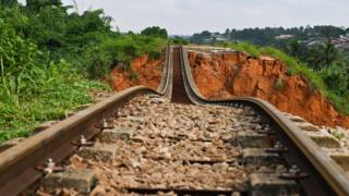 A suspended railway track at the site of a landslide that killed 13 people the day before, in Anyama, near Abidjan -19 June 2020