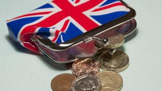 Union Jack purse with coins coming out