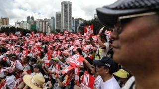 Protesters attend a rally against a controversial extradition law proposal in Hong Kong on 9 June 2019