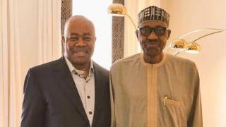 President Muhammadu Buhari and senator Godswill Akpabio