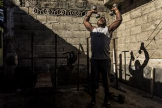 A man works out at one of the makeshift gyms