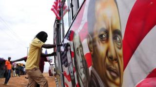 "Man boards a ""matatu"" minibus with a painting depicting US Presidents Abraham Lincoln and Barack Obama and US scientist Benjamin Franklin"
