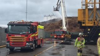 Firefighters at Alexandra Docks, Newport, after a wood chip fire
