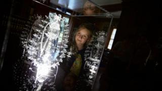 Girl looking at Luke Jerram sculpture at Brodie Castle