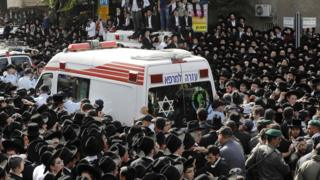 Followers of Rabbi Aharon Shteinman attend his funeral in the Israeli town of Bnei Brak on 12 December 2017
