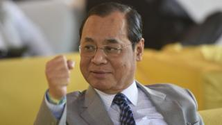 India's Chief Justice Ranjan Gogoi photographed in New Delhi with a clenched fist in July 2018