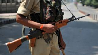 An Indian Central Reserve Police Force (CRPF) officer stands guard, 28 August 2010