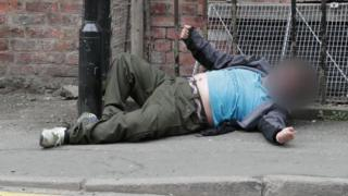 Man lay sprawled on street in Manchester