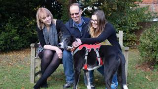 Bud with his new owners, the Corns family