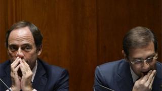 Portuguese Prime Minister Pedro Passos Coelho (right) sits beside Portuguese Vice Prime Minister Paulo Portas during a debate at the Portuguese Parliament in Lisbon on 9 November