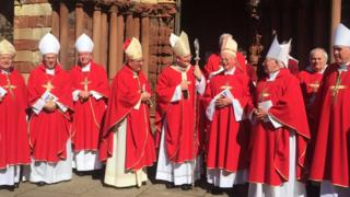 Bishops outside cathedral