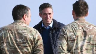 Gavin Williamson with soldiers in April
