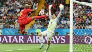 Belgium defender Vincent Kompany (left) is trying to score a goalkeeper from Japan, Eiji Kawashima during the Belgium-Japan match on July 2.