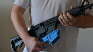 An AR-15 assault rifle along with a 3D-printed lower receiver