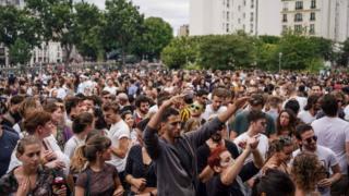 People attending an event for Fete de la Musique in Paris